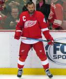 Henrik Zetterberg stands at the boards during pre-game warmups.