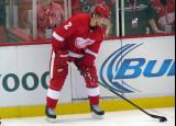 Brendan Smith handles a puck at the boards during pre-game warmups.