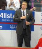 Detroit assistant coach Jim Hiller stands behind the bench.