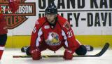 Shane Berschbach stretches near the boards during pre-game warmups before a Grand Rapids Griffins game.