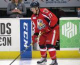 Colin Campbell stickhandles near the bench during pre-game warmups before a Grand Rapids Griffins game.