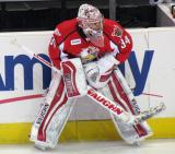 Petr Mrazek crouches at the boards during pre-game warmups before a Grand Rapids Griffins game.