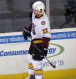 Chris Butler of the Chicago Wolves skates along the boards during pre-game warmups before a game against the Grand Rapids Griffins.