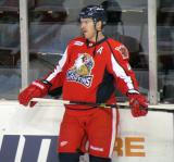 Brennan Evans stands at the boards during pre-game warmups before a Grand Rapids Griffins game.