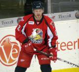 Kevin Porter tracks a puck during pre-game warmups before a Grand Rapids Griffins game.