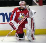 Petr Mrazek stretches at the bench during pre-game warmups before a Grand Rapids Griffins game.