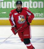 Chris Bruton skates in the neutral zone during pre-game warmups before a Grand Rapids Griffins game.