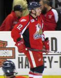 Kevin Porter skates at the bench during pre-game warmups before a Grand Rapids Griffins game.