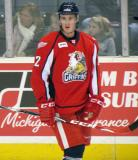 Louis-Marc Aubry stands at the boards during pre-game warmups before a Grand Rapids Griffins game.