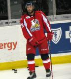 Landon Ferraro stands near the boards during pre-game warmups before a Grand Rapids Griffins game.