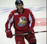 Xavier Ouellet calls out to his teammates during pre-game warmups before a Grand Rapids Griffins game.