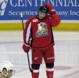 Andy Miele adjusts his helmet during a stop in play in a Grand Rapids Griffins game.