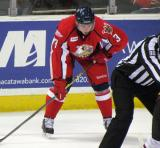 Alexey Marchenko crouches before a faceoff during a Grand Rapids Griffins game.