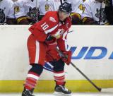 Jeff Hoggan skates in front of the Chicago bench during a Grand Rapids Griffins game.