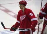 Luke Glendening stands at center ice during pre-game warmups.