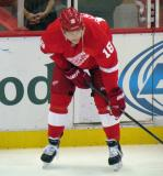 Joakim Andersson crouches at the boards during pre-game warmups.