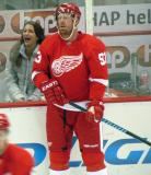 Johan Franzen stands at the boards during pre-game warmups.