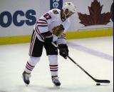 Johnny Oduya stickhandles during pre-game warmups before a game against the Detroit Red Wings.