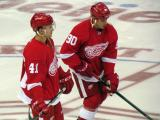 Luke Glendening and Stephen Weiss stand at center ice during pre-game warmups.