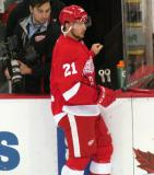 Tomas Tatar stands at the bench during pre-game warmups.