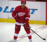 Tomas Tatar skates near center ice during pre-game warmups.