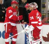 Drew Miller and Petr Mrazek stand at the bench during pre-game warmups.