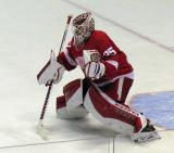 Jimmy Howard comes out to the top of his crease to face a shot during pre-game warmups.