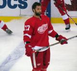 Kyle Quincey stands near the blue line during pre-game warmups.