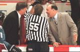 Marc Crawford screams at Scotty Bowman with a ref and a camera man caught in the middle.