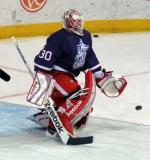 Tom McCollum kneels at the top of his crease during pre-game warmups before the Grand Rapids Griffins' Purple Game.