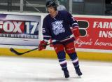 Mitch Callahan skates near the boards during pre-game warmups before the Grand Rapids Griffins' Purple Game.