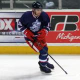 Brian Lashoff skates along the boards during pre-game warmups before the Grand Rapids Griffins' Purple Game.