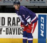 Ryan Sproul crouches near the boards during pre-game warmups before the Grand Rapids Griffins' Purple Game.