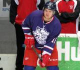 Xavier Ouellet looks to make a pass during pre-game warmups before the Grand Rapids Griffins' Purple Game.