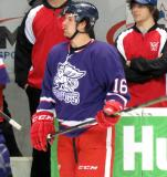 Xavier Ouellet stands near the bench during pre-game warmups before the Grand Rapids Griffins' Purple Game.