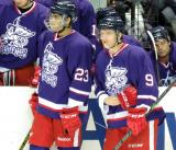 Andreas Athanasiou and Mark Zengerle stand at the Griffins bench prior to the Grand Rapids Griffins' Purple Game.