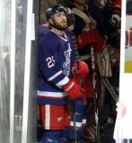 Landon Ferraro stands in the tunnel behind the bench prior to the start of the second period of the Grand Rapids Griffins' Purple Game.