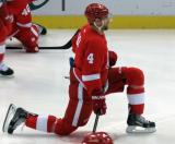 Jakub Kindl kneels on the ice during pre-game warmups.