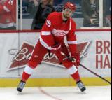 Riley Sheahan looks to make a pass from the boards during pre-game warmups.
