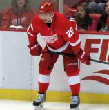 Tomas Jurco crouches at the boards during pre-game warmups.