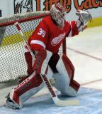 Jimmy Howard raises his glove at a shot during pre-game warmups.