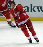 Eric Cole skates during pre-game warmups.