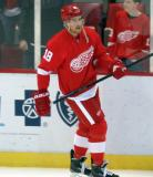 Joakim Andersson skates along the boards during pre-game warmups.