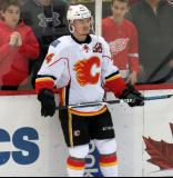 Jiri Hudler of the Calgary Flames stands at the boards during pre-game warmups before a game against the Detroit Red Wings.