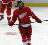 Kyle Quincey skates in the neutral zone during pre-game warmups.