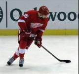 Riley Sheahan skates with the puck during pre-game warmups.
