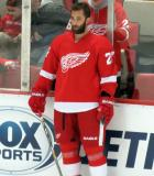 Kyle Quincey stands at the boards during pre-game warmups.