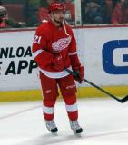 Tomas Tatar stands near the corner during pre-game warmups.
