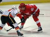 Luke Glendening gets set for a faceoff against Mikael Backlund of the Calgary Flames.