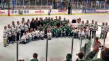 The Plymouth Whalers pose for a photo at center ice following the last game in franchise history.